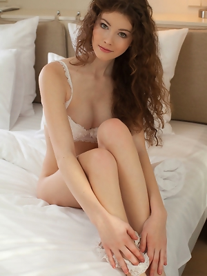 """Adel C looks sexy and confident in her white matching lingerie, posing erotically and without any hint of inhibition on top of a crisp white bed"